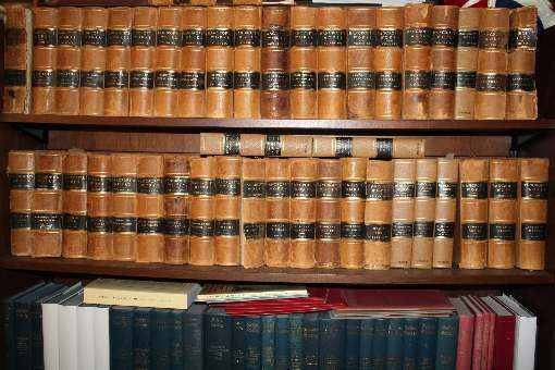 upper shelf Complete Works of H. H. Bancroft, <br> lower shelf volumes of the Selden Society